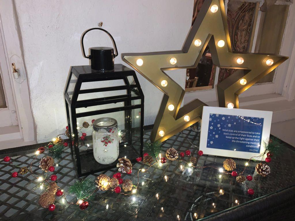 Star and lantern decor with Christmas lights