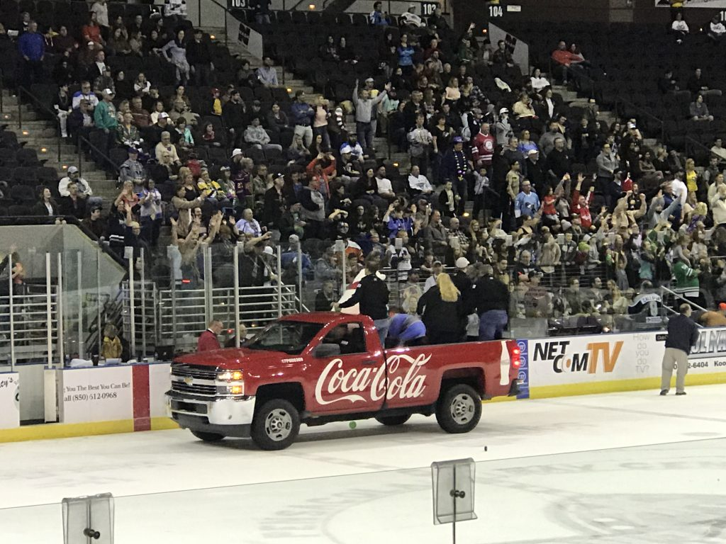 The excited crowd tries to catch beads thrown from the Coca-Cola truck