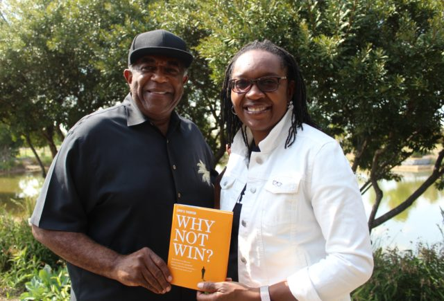 Larry Thornton and Zillah Fluker holding Larry's book