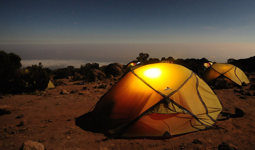 several tents set up for the night on an excursion