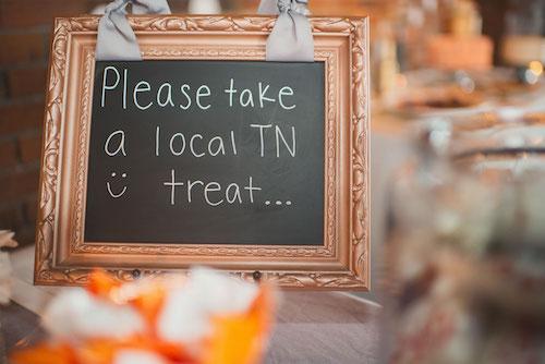 Sign saying please take a local TN treat