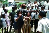 Embera Couple Dancing in the Streets of Quibdó at Easter by Larry Kincaid