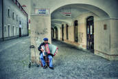 Busker with Accordion by Clark Gray
