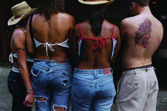 Four tattooed torsos