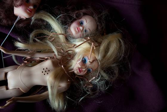 Dolls with staples