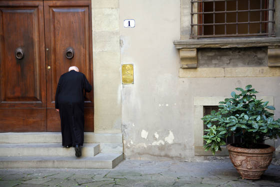 Priest and door
