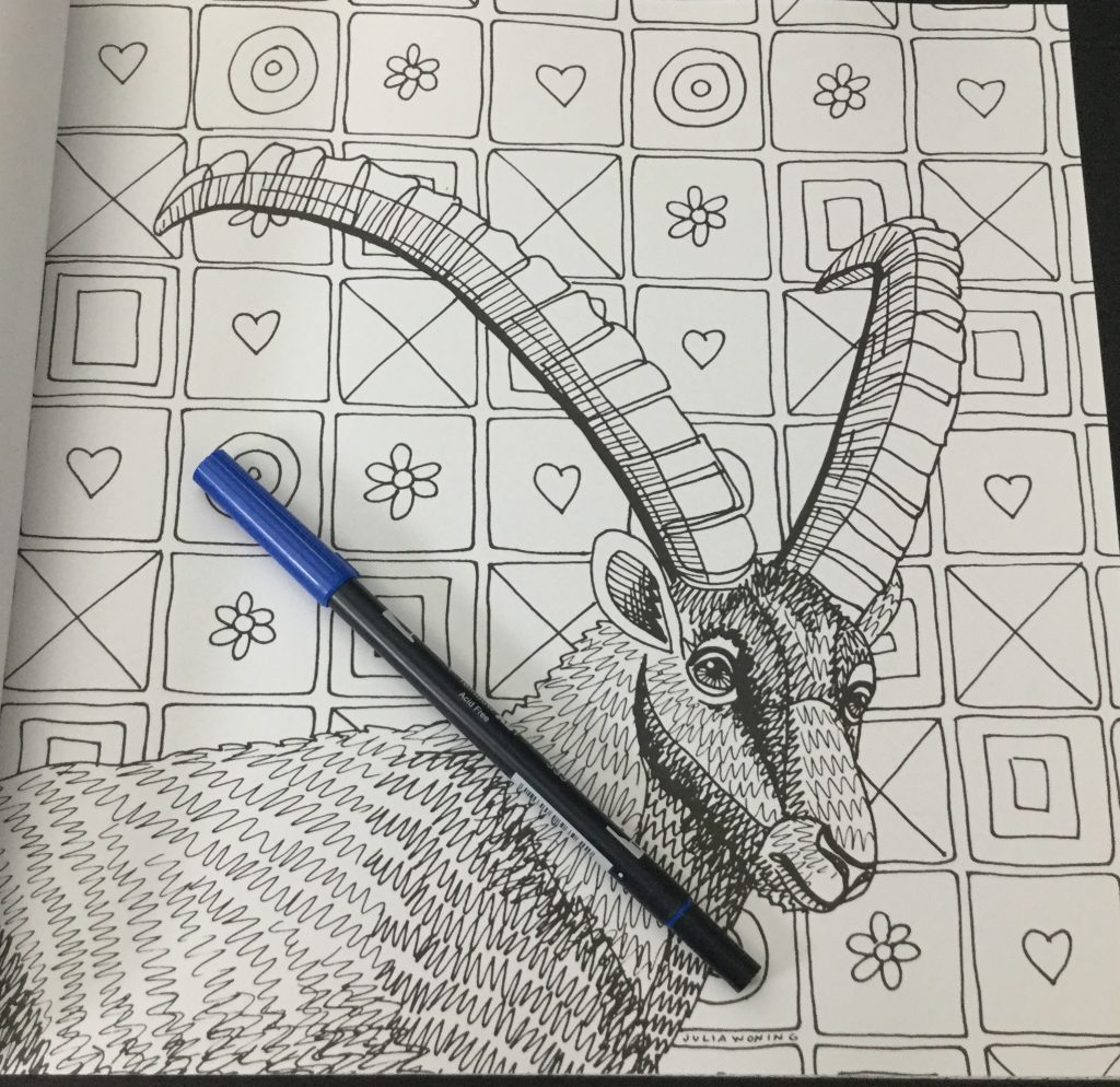 Antlered animal against wallpaper background