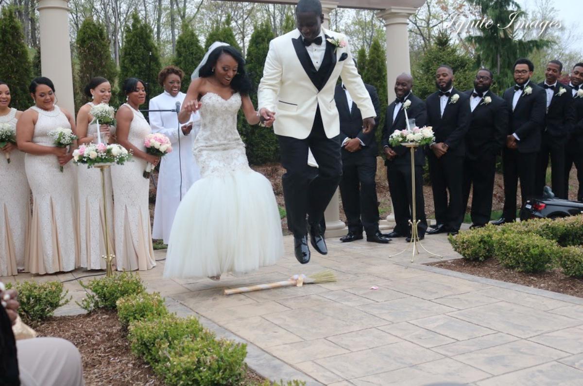 couple jumping broom