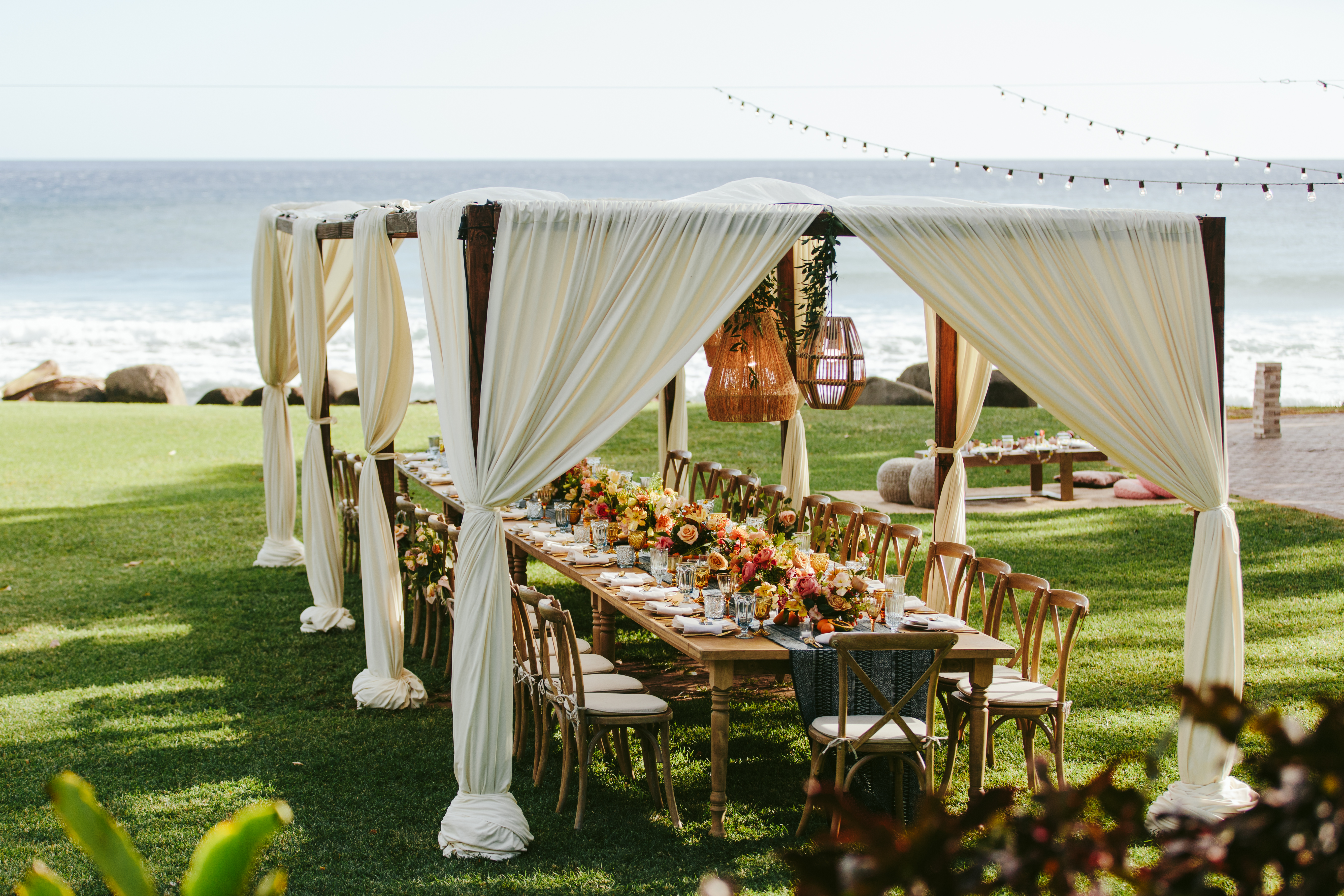 outdoor wedding reception setup with overhead canopy