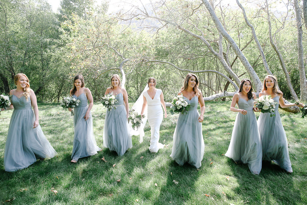 bride and bridal party outdoors