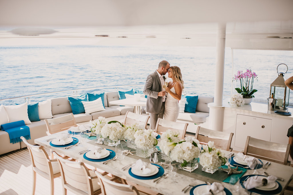 couple dancing on yacht at reception