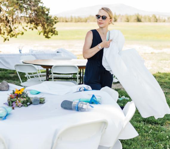 Naomi Russell setting up an outdoor wedding