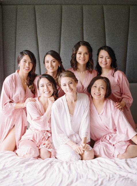 Bridesmaids Sitting on Bed