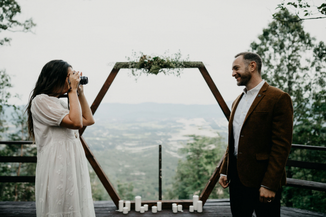 Bride Taking Picture of Groom