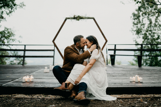 Newlyweds Sitting in Front of Arch