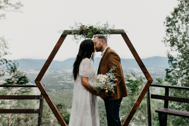 Couple Kissing in Front of Arch