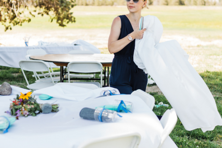 Naomi Russell setting up an outdoor wedding