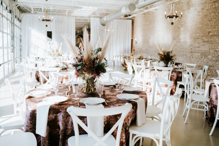 bohemian chic indoor wedding reception setup