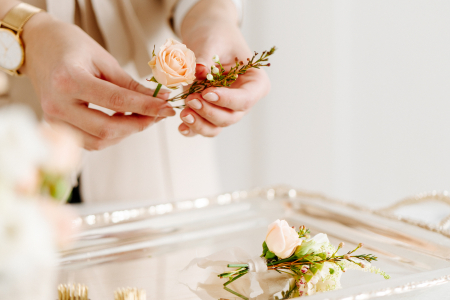 woman arranging flowers for table setting
