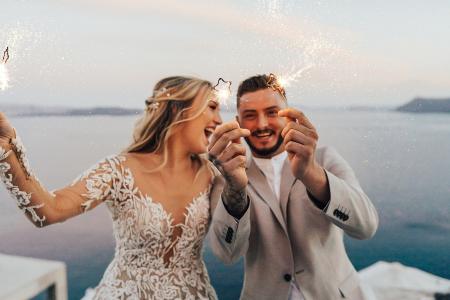 couple smiling with sparklers in hand