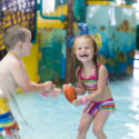 two kids playing in waterpark