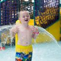 Child playing at waterpark