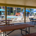 Picnic table setup by the outdoor pool
