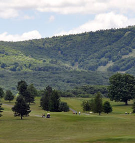 Golfers stroll the beautiful valley course.
