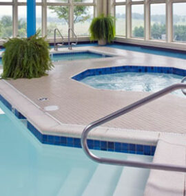An inviting pool and a bubbling jacuzzi overlook Canaan Valley