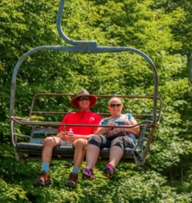Couple on chairlift in summer