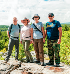 2 couples posing at scenic overlook