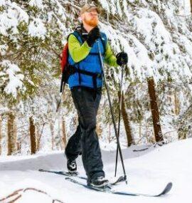 Cross-Country skier traversing through trees