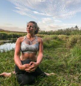 Woman doing yogo outdoors
