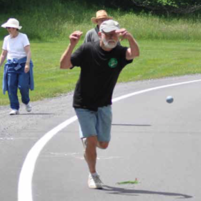 Group of people playing bocce ball