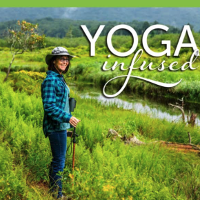 Person standing next to creek on Yoga Infused walk