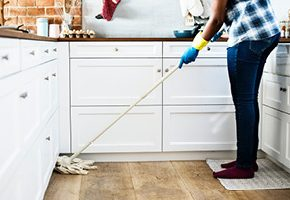 Woman mopping kitchen floors