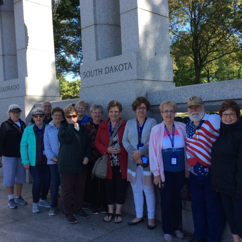 People in front of the South Dakota area of the WWII memorial