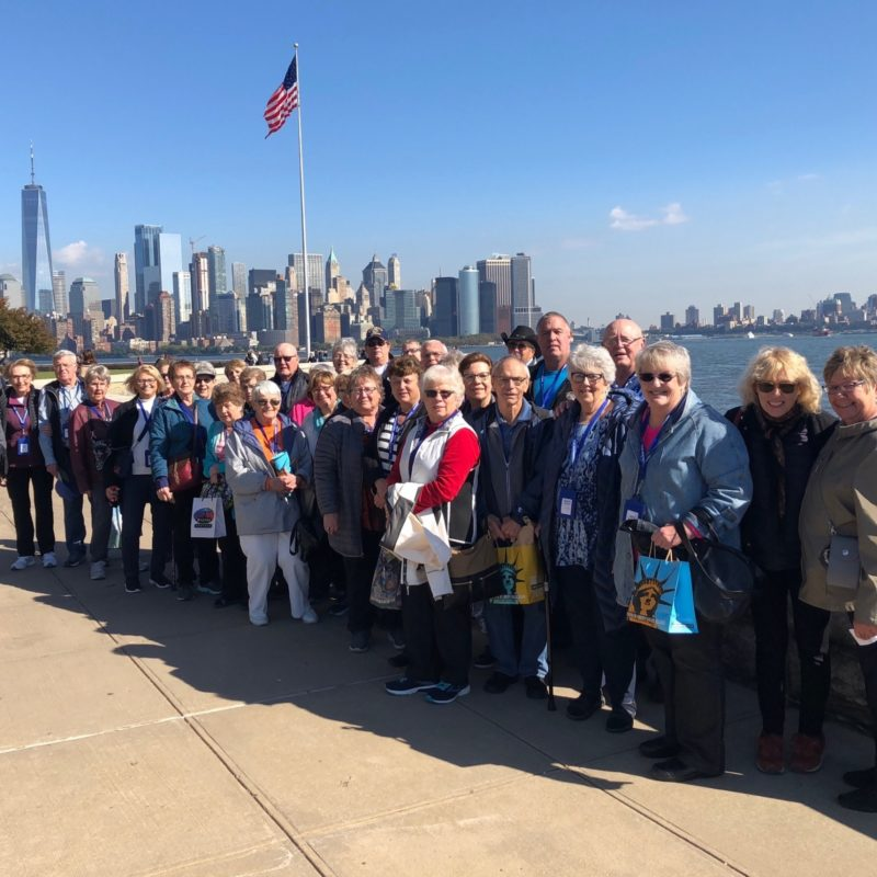 Standing on Ellis Island with New York in Background