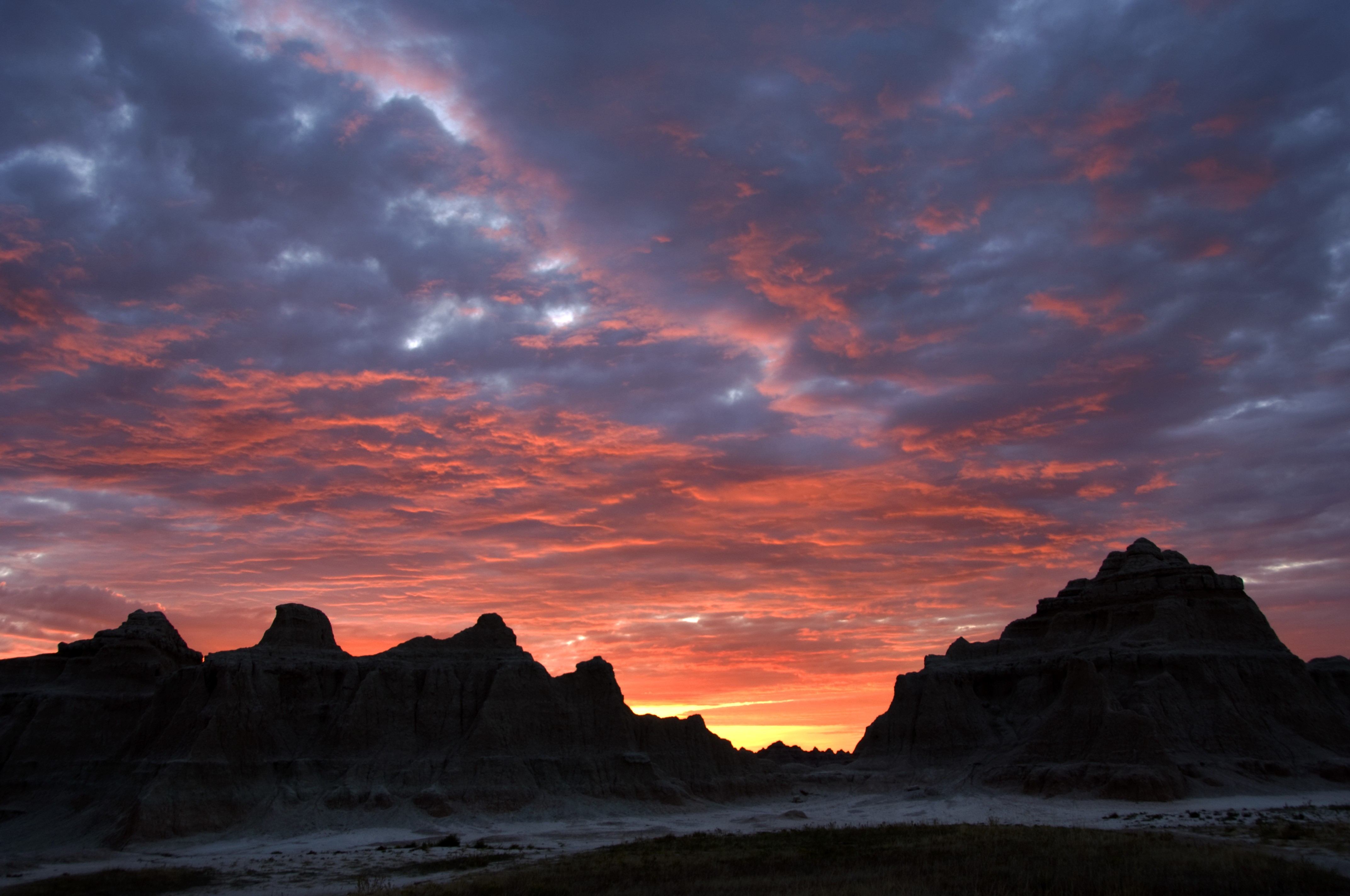 Colorful Sunrise Over a Ridgeline in Badlands National Park