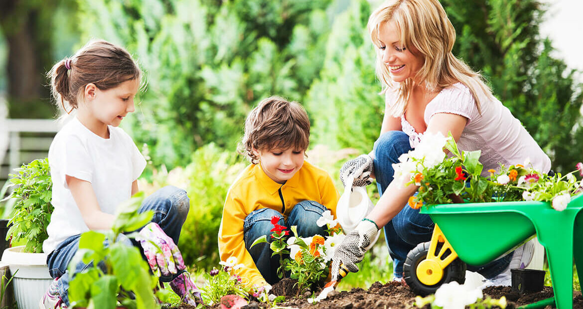 Mother Gardening with Son and Daughter