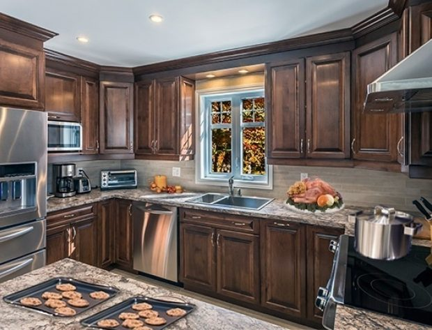 Photo of kitchen with cookies sitting on the counter.