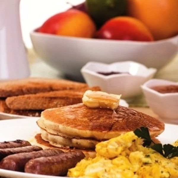 Breakfast with sausage, eggs, and pancakes