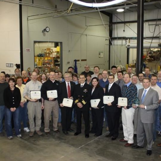 Commander Craig Laws Recognizes Aerostar's Contribution to Operating Enduring Freedom and PGSS