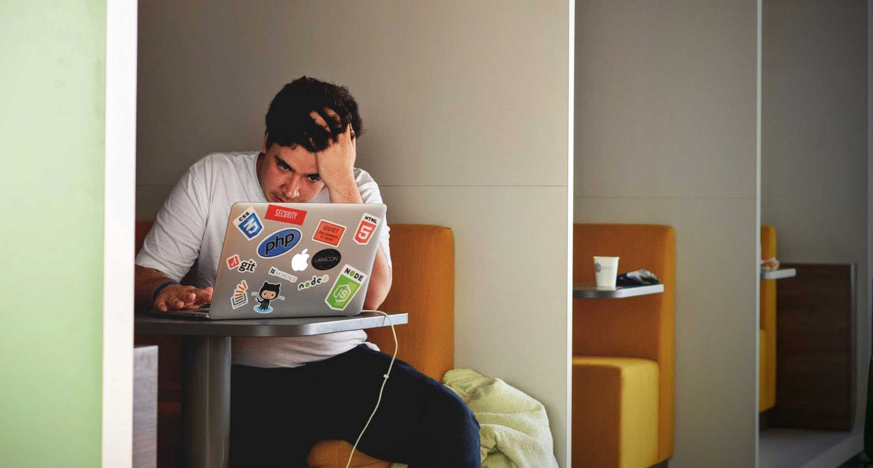 guy on computer wondering how he can manage college stress