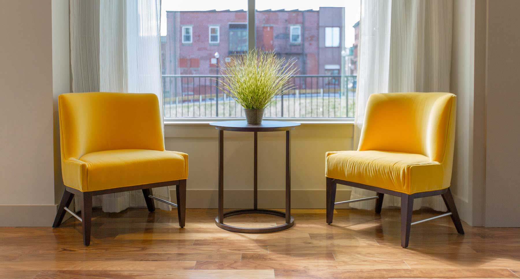 two yellow chairs facing each other ready for a professional counseling session