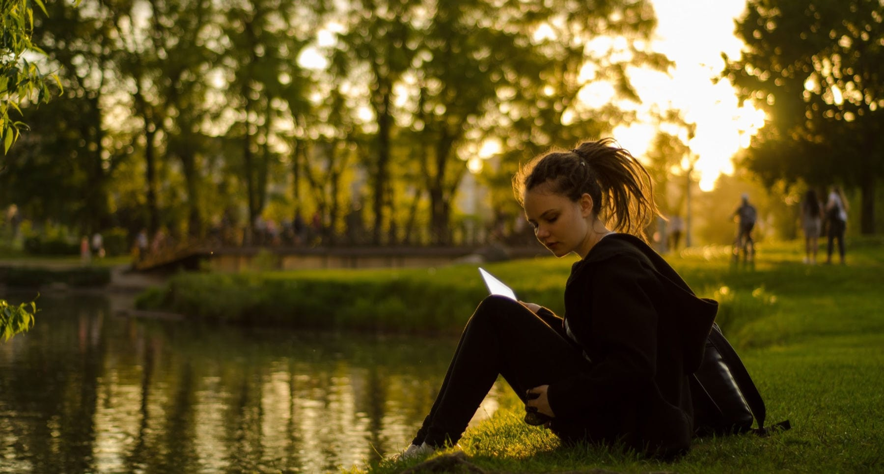 girl studying by pond learn more about God and His plan for you