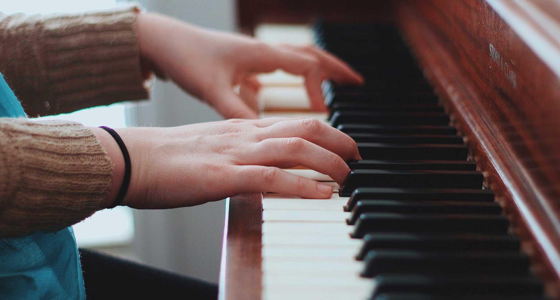 Woman Playing a Piano at Church