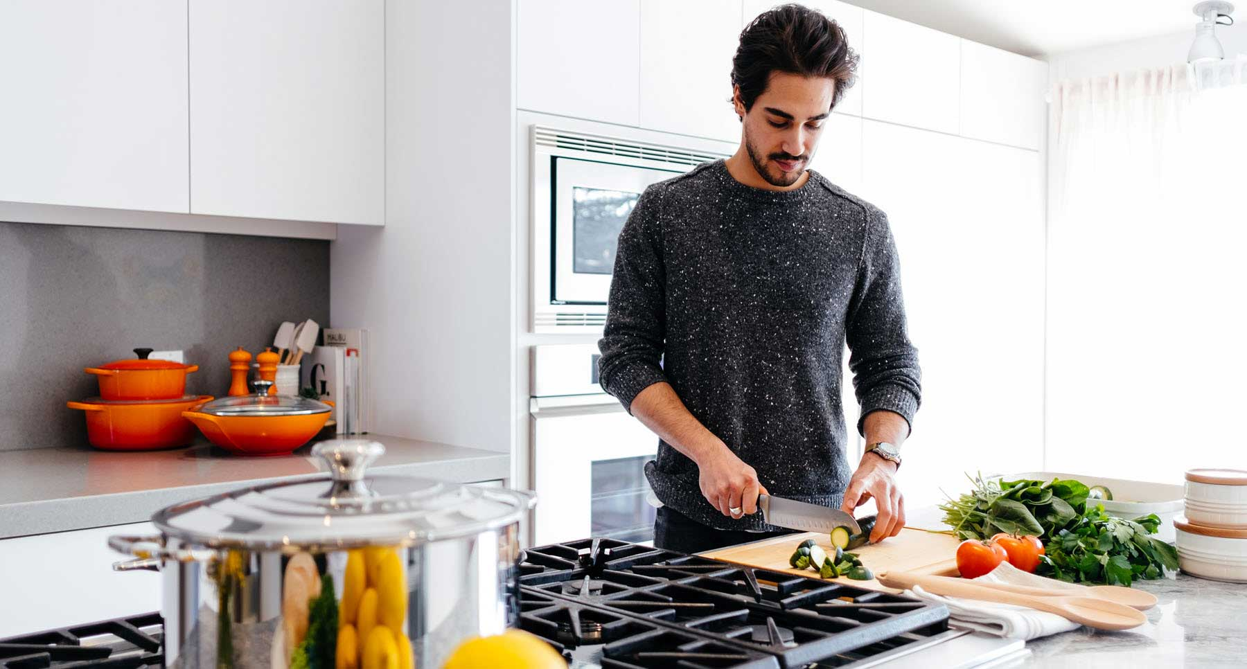 guy cooking healthy food in the kitchen for his mental health