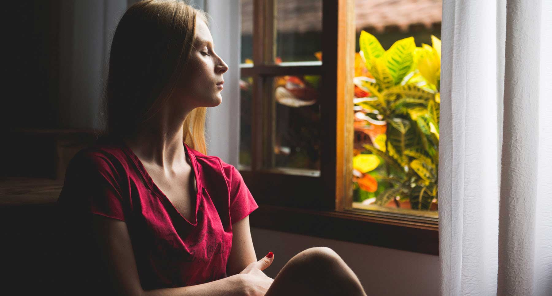 woman-looking-out-the-window-reflecting-on-her-shame-and-guilt