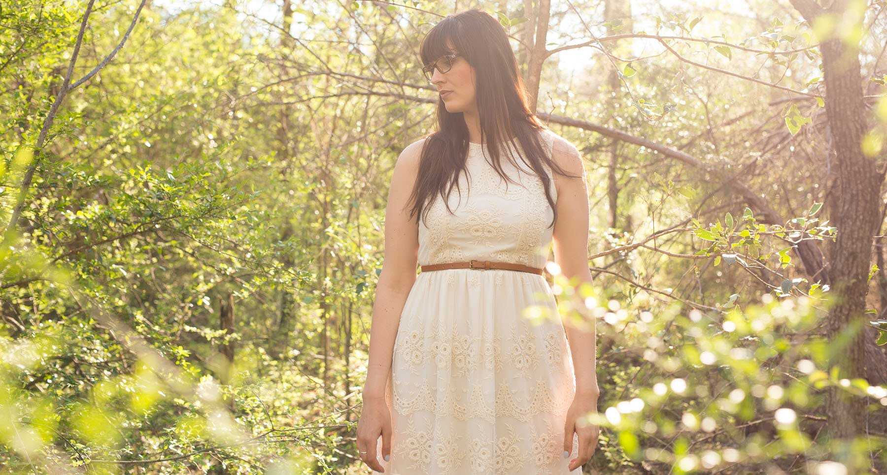 woman standing outside in a white dress struggling with fears and anxiety